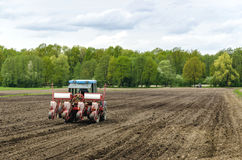 Planting seeds with tractor Royalty Free Stock Photo