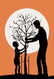 Planting tree. Father and little son planting a tree
