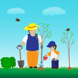 Planting tree with family in the garden Stock Image