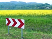 Plants for bio fuel production. Traffic sign in front of the field with plants of oil beet for bio fuel production Stock Photography