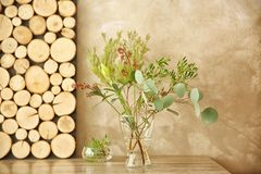 Plants composition in glass vase on table. In the room royalty free stock photography
