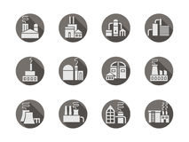 Plants and factories round gray icons set. White silhouette signs of factory buildings. Industrial architecture and facilities. Production and manufacturing Royalty Free Stock Images