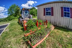 Free Plants Growing Through Old Mower Royalty Free Stock Image - 93962516