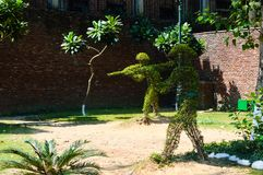 Plants shaped to depict British soldiers shooting into the crowd at the Amritsar massacre in Jallianwala Bagh, India. Topiary stock image