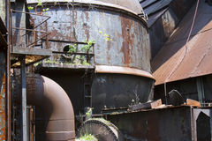 Plants and trees growing in rusting industrial site Stock Photos