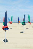 Planty of parasols on beach Stock Photography
