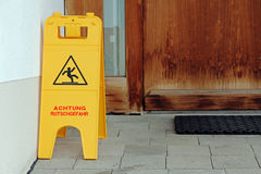 Plaque - Attention slip hazard Royalty Free Stock Photo