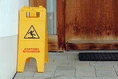 Plaque - Attention slip hazard. Warning slippery floor royalty free stock photo