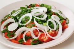 Plaque avec de la salade Photo stock