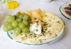 Plaque avec du fromage Photographie stock libre de droits