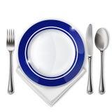 Plaque avec la cuillère, le couteau et la fourchette Images stock