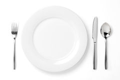 Plaque avec la cuillère, le couteau et la fourchette Photos libres de droits