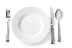 Plaque avec la fourchette, le couteau et la cuillère images libres de droits