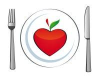 Plaque avec le coeur de pomme Photo stock