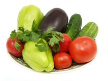 Plaque avec les légumes frais. D'isolement. Image libre de droits