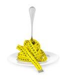 Plaque avec une fourchette et une bande de mesure Concept de régime Images stock