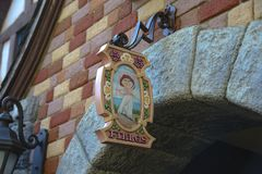 Plaque of the bathrooms of women, inside the Disneyland Park, Paris. FRANCE, PARIS - February 29, 2016 - decorative detail of the entrance to the bathrooms of royalty free stock image
