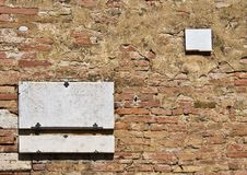 Plaque on the brick wall. Old plaque on the brick wall Stock Image