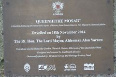 Queenhithe Mosaic along the North Bank of the Thames. Plaque commemorating the unveiling of the Queenhithe Mosaic on the North Bank in London UK Royalty Free Stock Images