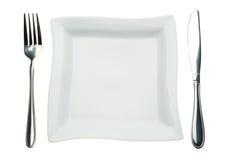 Plaque, couteau et fourchette carrés Image stock