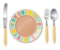 Plaque de Brown, cuillère en acier, fourchette, couteau Photographie stock