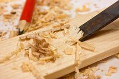 Plaque de burin, de sciure et en bois Photographie stock