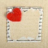 Plaque de carton et coeur de feutre Photo libre de droits