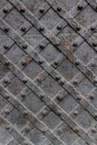 Plaque de métal avec plats tordus Photo stock