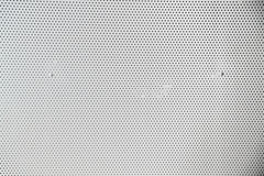 Plaque de métal grise avec des points et des vis Image stock