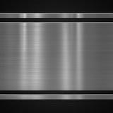 Plaque de métal sur le fond de carbone Photos libres de droits