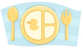 Plaque de nourriture de Childs avec la cuillère et la fourchette Images libres de droits