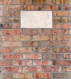 Plaque in een Bakstenen muur Royalty-vrije Stock Foto's