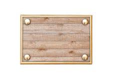 Plaque en bois dans un cadre en métal Photographie stock libre de droits