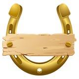 Plaque en fer à cheval et en bois Photo stock