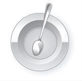 Plaque et cuillère de dîner vides Photo stock