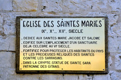 Plaque explaining the history of the church of Saintes-Maries-de Royalty Free Stock Photo