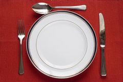 Plaque, fourchette, couteau et cuillère Photos stock