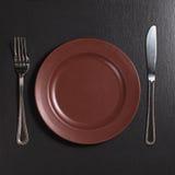 Plaque, fourchette et couteau images libres de droits