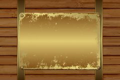 Plaque. Grunge plaque on wooden background Stock Photos