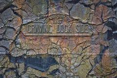Plaque latérale implorante de dock Photographie stock