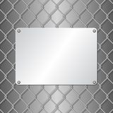 Plaque. Metallic plaque on wire mesh background Royalty Free Stock Photos