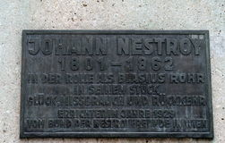 The plaque on the monument to the Austrian playwright, comic actor, Opera singer Johann Nestroy. Stock Images