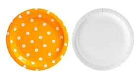 Plaque ? papier orange de point de polka d'isolement sur le fond blanc Plat de partie fait ? partir du carton dans le concept col photographie stock libre de droits