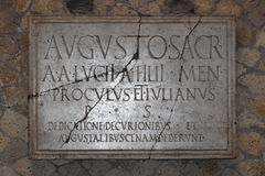 Plaque to Augustus, Herculaneum Archaeological Site, Campania, Italy. Herculaneum or Ercolano, Campania, Italy was an ancient Roman town destroyed by volcanic royalty free stock image