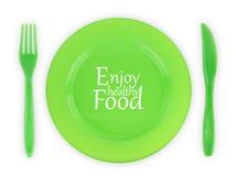 Plaque verte avec la fourchette et le couteau Photos stock