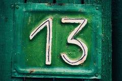 Plaque verte avec le numéro 13 Photo stock