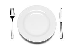 Plaque vide avec la fourchette et le couteau. Photographie stock libre de droits