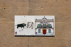 Plaque on a wall in Pamplona, Spain symbolizing the Running of the Bulls stock image