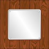 Plaque. White plaque on dark wooden planks Stock Photos