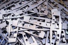 Plaques de métal après traitement sur la presse de découpage image libre de droits